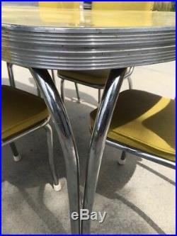 Vintage 1950's formica table and chairs great condition